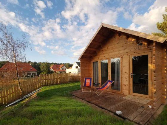 tygodniksanocki glowne domki letniskowe eko architektura 560x420 - Dlaczego warto postawić dom z drewna?